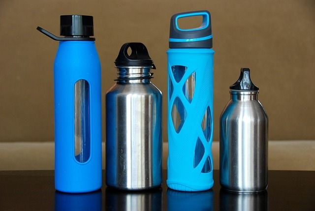 Four reusable water bottles on a table