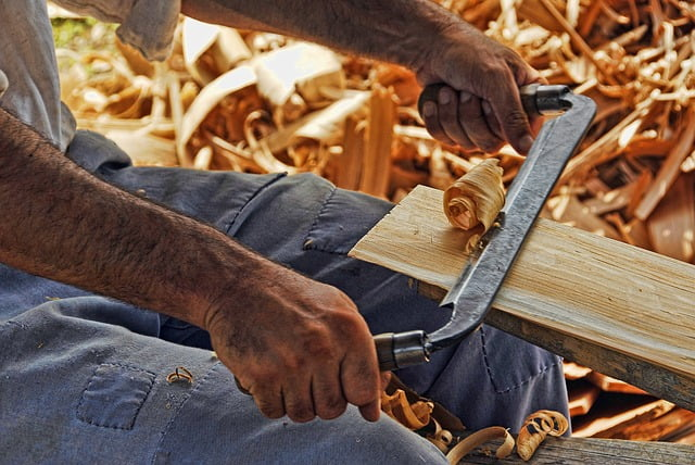 Shaving wood with a drawknife
