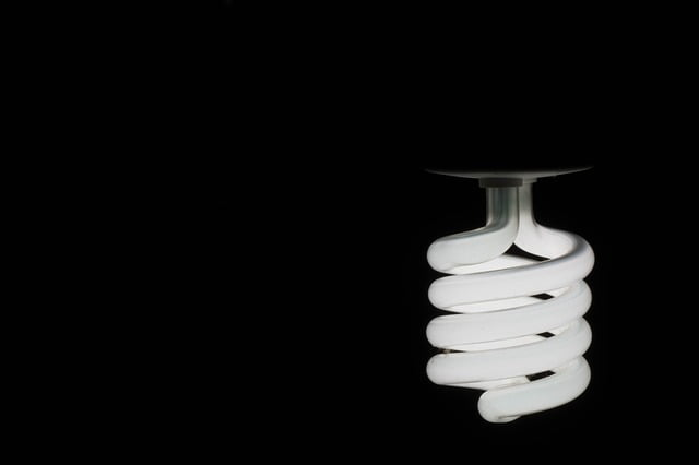 CFL Light Bulb in a dark room