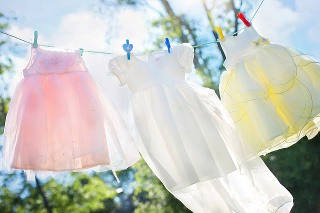 Clothes hanging on a clothesline outside, being air-dried
